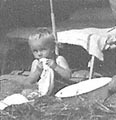 Ken Elmes (very young, in tent)